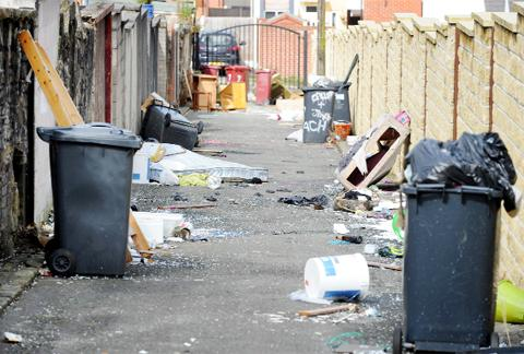 Rubbish strewn all over the rear of Leach Street in Blackburn