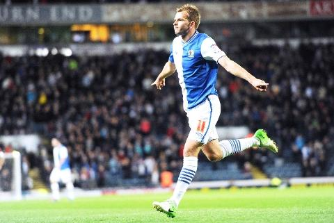 Lancashire Telegraph: GET IN Jordan Rhodes celebrates his goal last night - but the former Huddersfield man's fee upset Barnsley boss Keith Hill