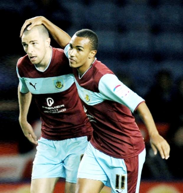 JOY AND PAIN Dean Marney is congratulated on his goal by Junior Stanislas