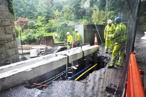 MAJOR PROJECT Engineers work to repair the collapsed road in Strongstry, Rossendale