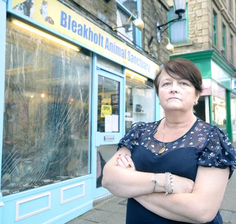 Diane Riley surveys the damage at the Bleakholt shop