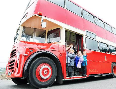 ALL ABOARD Pupils explore the double-decker bus