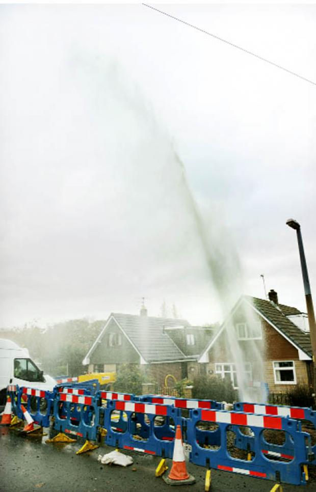 WHOOSH! The water burst forces a 40ft gusher into the air at Pinewood, Blackburn