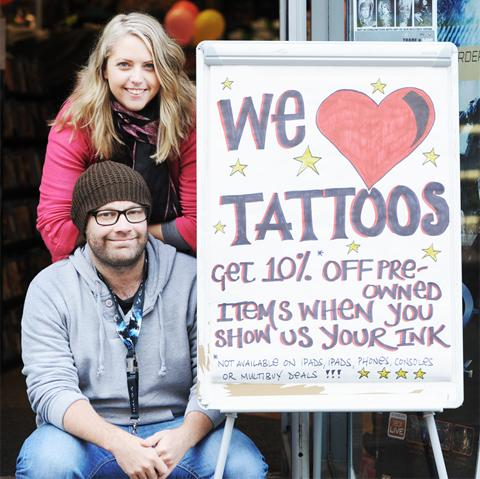 Jon Bee and Kelly Thomas with their pro-tattoo sign