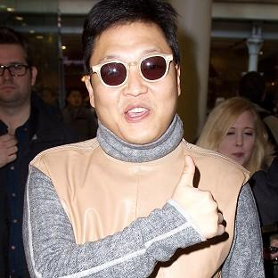 Psy has arrived in the UK and was greeted by screaming fans