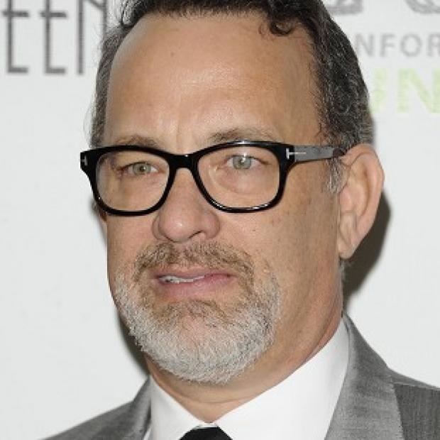 An insurance broker has been accused of overcharging Tom Hanks (AP Photo)