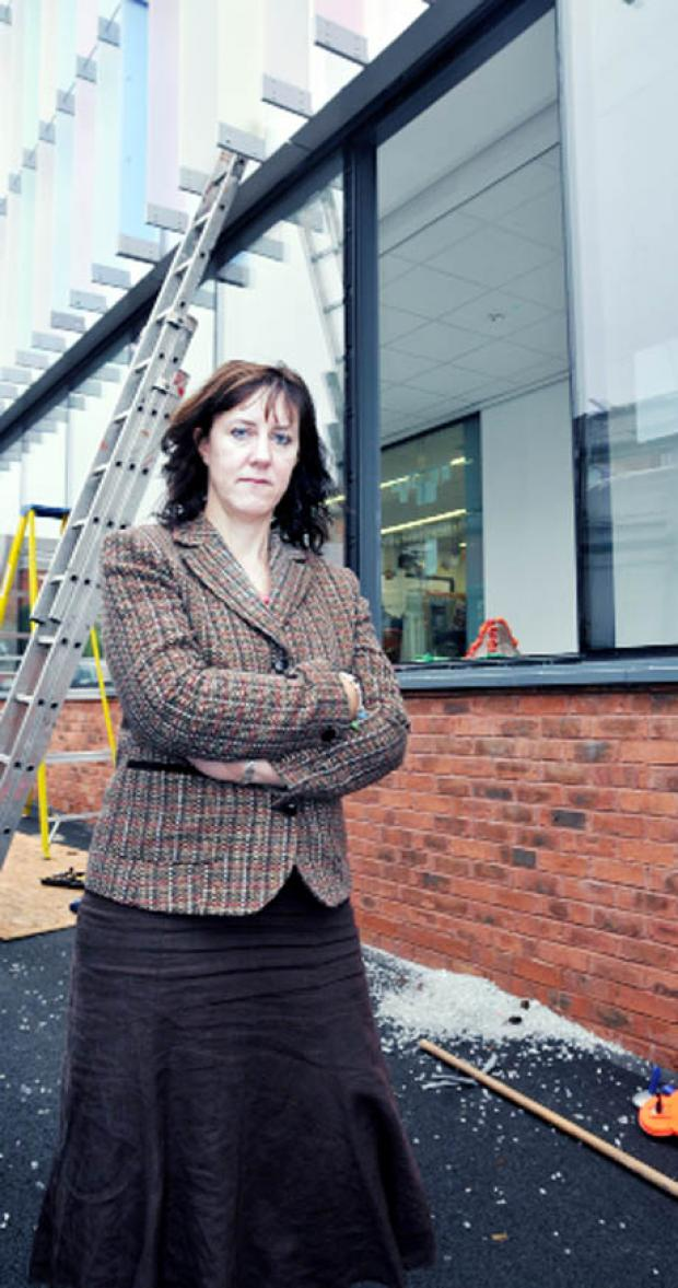 ANGER Head teacher Hillary Hinchliff in front of the latest damage