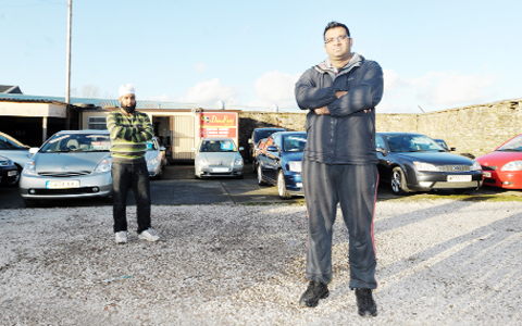 Sales assistant Mohammad Malik and manager Javed Imran at Daisyfield Garage, in Fort Street, Blackburn, where an Audi A3 was stolen