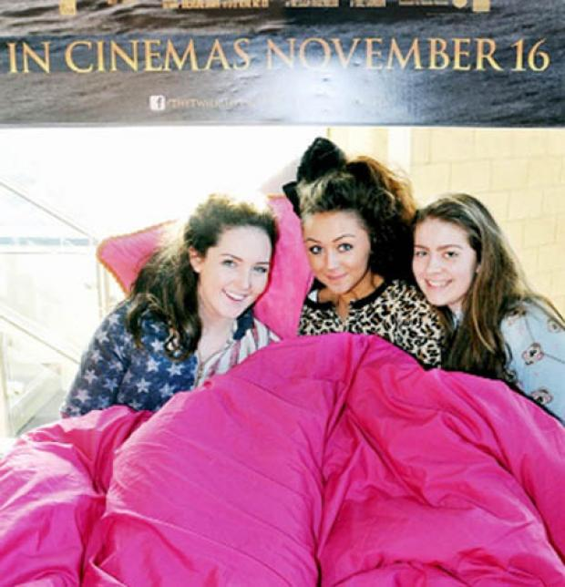 SNUGGLED UP All ready for the marathon Twilight Saga are, from left,  Kiera Coyle, Melissa Mancini and Katie Baldwin.