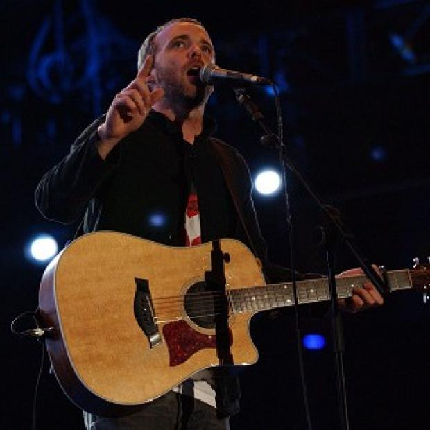Travis frontman Fran Healy has been given an honorary degree in recognition of his musical achievements