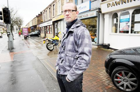 Paul Harrison outside shops in Blackburn Road