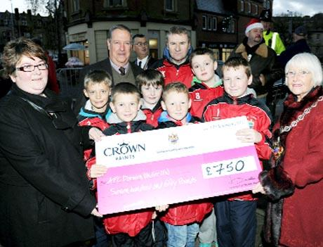 IT'S A GIFT Tracy Riley and Vernon Kinrade, from Crown Paints, with town council mayor Eileen Entwistle and recipients AFC Darwen under-11s.