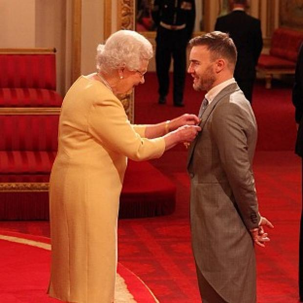 Gary Barlow was awarded his OBE by the Queen