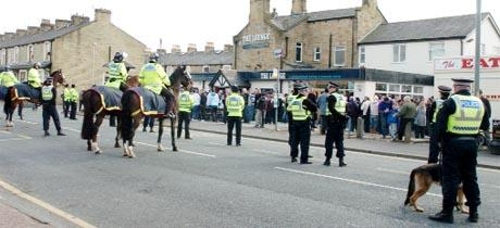 LARGE NUMBERS  Police officers on patrol outside Turf Moor at the last derby game