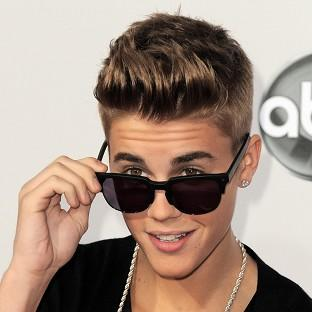 Justin Bieber won't face charges over an alleged scuffle with a photographer