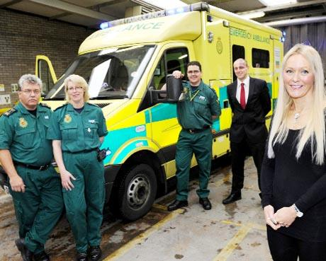 LIFE SAVERS Clare Holgate with ambulance crew, from left, Ian Mullineaux and Sharon Tyldsley (EMT1) and Paul Allenby, paramedic, and husband Stephen Holgate, at Burnley Ambulance Station