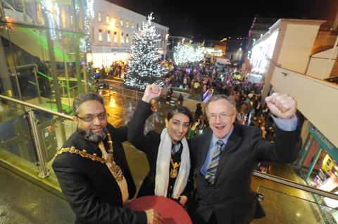 Mayor Coun Zamir Khan with daughter Bushra and chief executive Harry Catherall do the honours