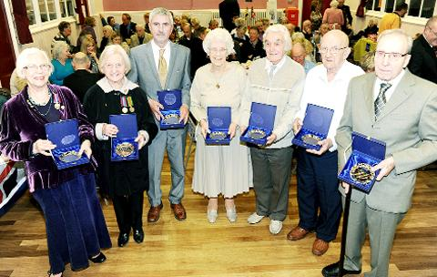 Earby Town Council honours seven World War Two veterans with the freedom of the town. From left, Marie (Bellamy) Keating, Vera (Bradwell) Cant, Martin Foster on behalf of Clive Foster, Lilian Bradley, Dennis Peachey, Reginald Russell and Edwin Arthur Wats