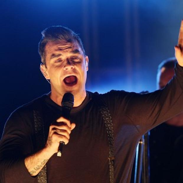 Robbie Williams has announced he is planning a stadium tour