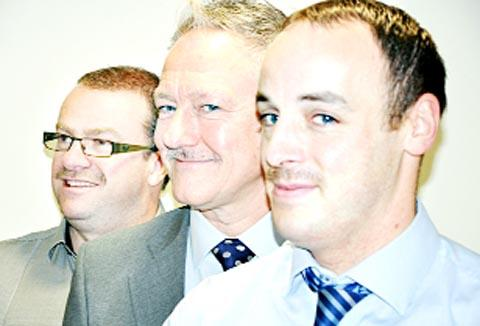 HERE WE GROW Stuart Wright (front) gets support for Movember from Calico Homes colleagues Gary Rooke and Stephen O'Hagan