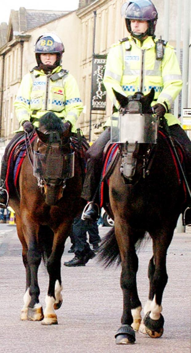 FOOTBALL FLASHBACK Mounted police on duty in Burnley town centre before the last derby clash between Clarets and Rovers