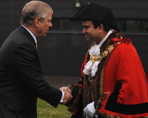 Prince Andrew is greeted by the mayor of Pendle  Asjad Mahmood at Nelson and Colne College.