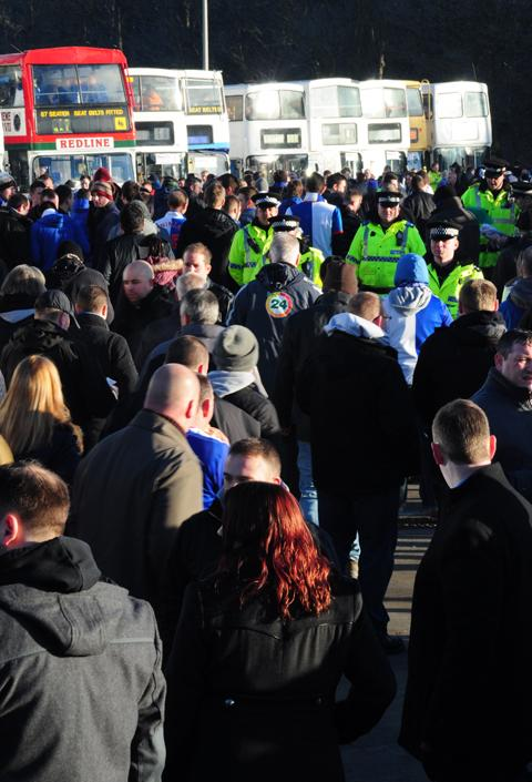 Rovers fans board the buses at Turf Moor this morning.