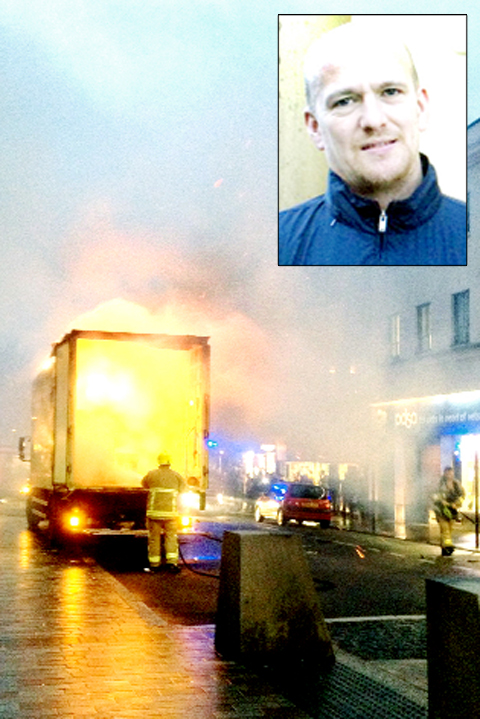 The burning lorry and (inset) driver Martin Ford