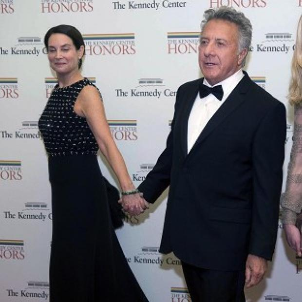 Dustin Hoffman arrives at the Washington event with his wife Lisa