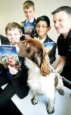 PC Gareth Dixon and his springer spaniel Jack with Witton Park students