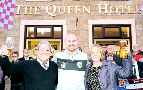 Clarets boss Sean Dyche is officially welcomed by Graham and Carole Knott as he opens The Queen Hotel, Cliviger