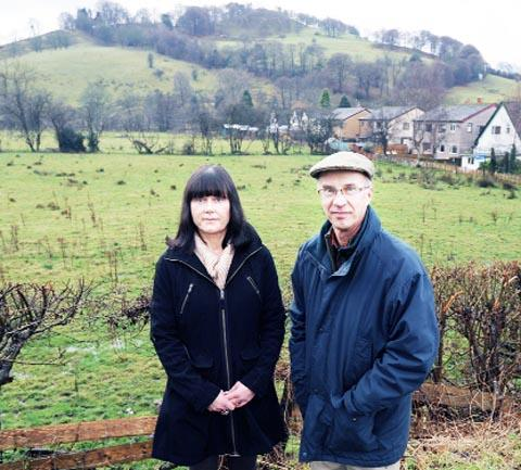 CONCERN Janet Higgins and Nick Walker at the site of the proposed homes