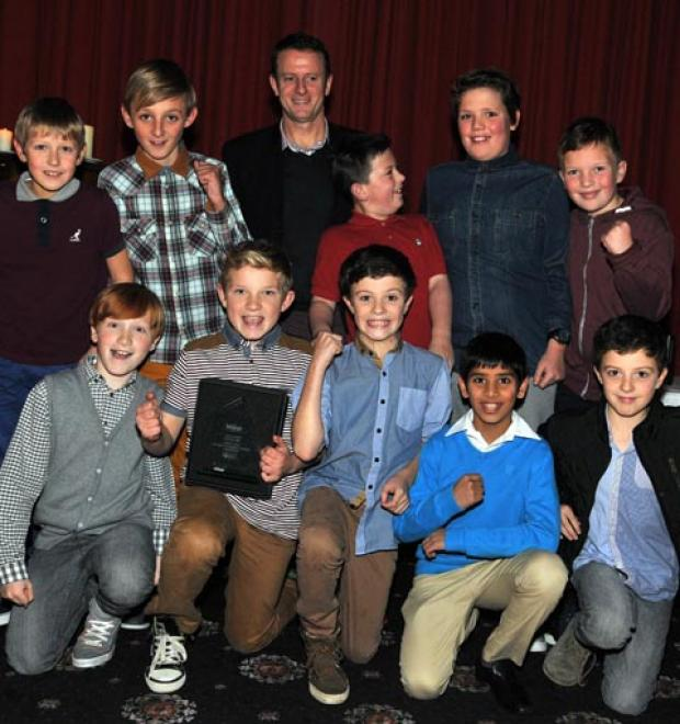 Footballers from St Francis Primary School, Blackburn, receive their award from former Rovers star Kevin Gallacher