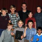 Footballers from St Francis Primary School, Blackburn, receive their award from former Rovers star Kevin Gallagher