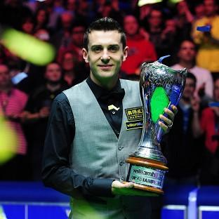 Mark Selby poses with the trophy after winning the UK Championship in York
