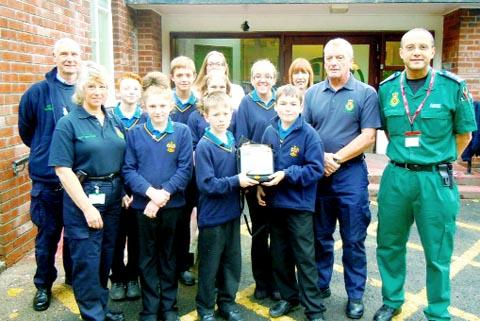 HEART HELP Brian Pickup, second right, hands over the first of the defibrillators