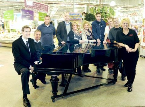 MUSICAL From left Samuel Hudson, Mark Smith – who set up the scheme, Anthony Bonner, market manager Keith Holden and stall holders Helen Brooks and Katie Elliott, Ethan Walsh, John Turner, Pete Ainsworth and Sharon Green
