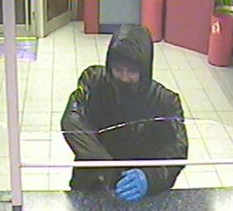 Police issue CCTV images of Burnley bookmaker robber