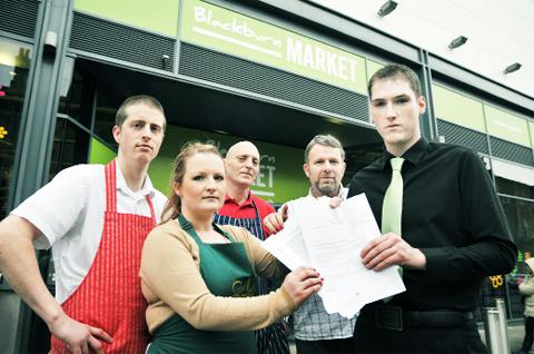 Lancashire Telegraph: Unhappy traders thinking of withholding their direct debits, from left, Jon Turner of Mayers Fishmongers, Katie McKay of Nuts Unlimited, Malcolm Marsden of Whitaker's Butchers, Stewart Cunliffe of Sanderson's and Daniel Moffett of Butler's Cafe