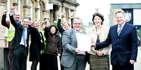 Nelson Town Hall workers celebrate the award with Coun Cooney (front left), HR manager Lesley Ritchie and chief executive Stephen Barnes