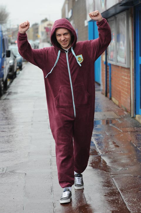 Burnley club shop assistant Kyle Howard models the onesie