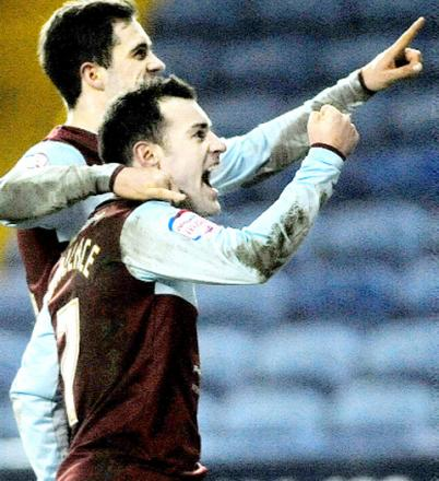 WALL OF FAME Ross Wallace celebrates his penalty yesterday