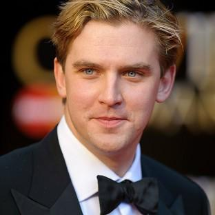 Downton Abbey star Dan Stevens has topped a list of the best dressed UK male celebrities