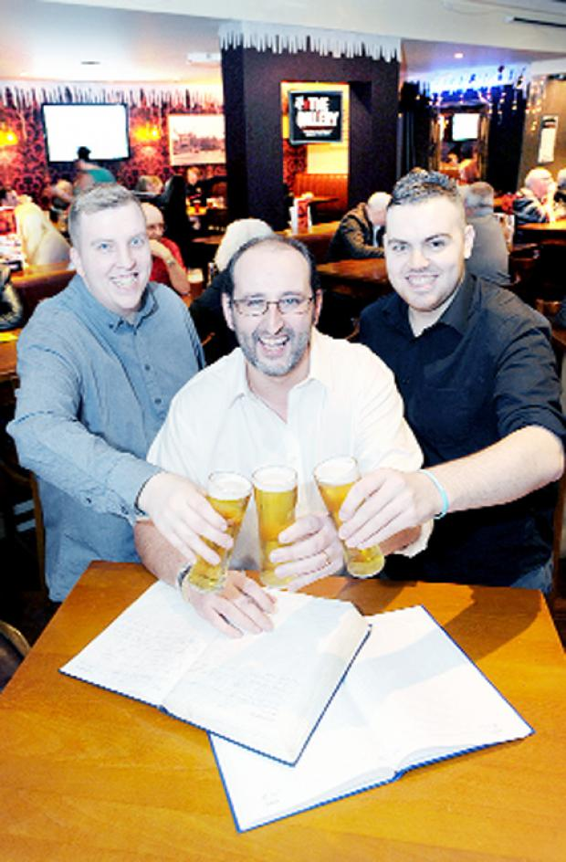 Pub managers Mark Hughlock, Adam Hulme and Martin Haynes celebrate festive sales