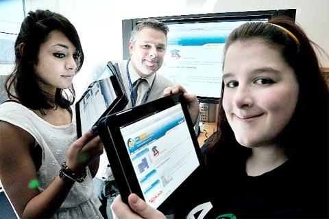 NEW AGE IT Manager Paul Holmes with pupils Athalia Willis, left, and Kathryn Fleming