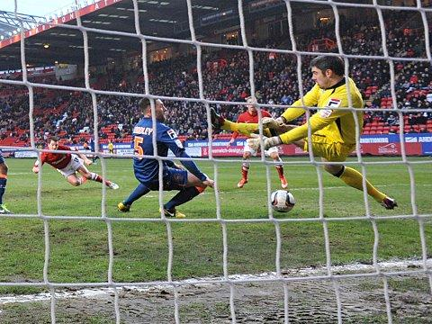 Yann Kermorgant is denied by Matt Gilks' save