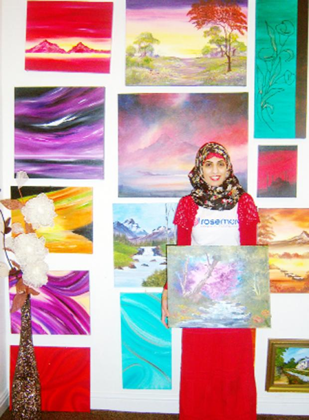 Kulsoom Satia with her artworks