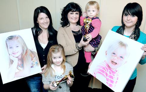 Jessica Foggarty and Georgia Miller with their mums Marie Hannan, left, and Amanda Woods, right, receive prizes from Abigail Timmins