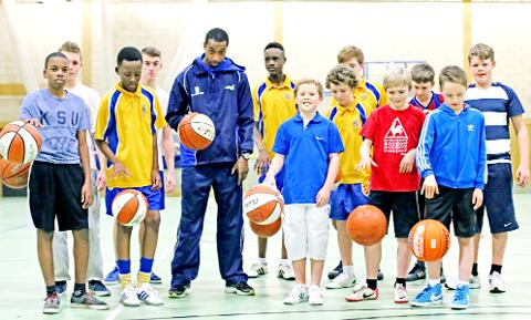 Stephen Gayle with young players. Photo: KIPAX