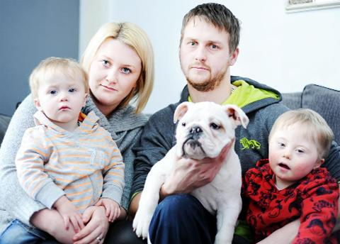 Adam and Samantha Garth with sons Isaac, left, and Tyler with dog Winston